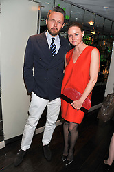 STELLA McCARTNEY and ALASDHAIR WILLIS at a party to celebrate the launch of Jax Coco - a new soft drink, held at Harvey Nichols 5th Floor Bar, 109-125 Knightsbridge, London on 25th June 2012.
