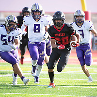 Grants' running back Isaiah Johnson (20) is chased by Kirtland defenders Saturday afternoon in the 2019 4A NMAA State Football Championship quarterfinal game against Kirtland Central at Grants High School in Grants. Grants beat Kirtland 56-13.