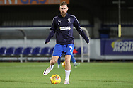 AFC Wimbledon midfielder Scott Wagstaff (7) warming up during the EFL Trophy group stage match between AFC Wimbledon and Stevenage at the Cherry Red Records Stadium, Kingston, England on 6 November 2018.