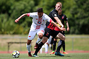 Waitakere United's Eder Franchini Pasten and Canterbury's James Pendrigh contest for the ball. ISPS Handa Premiership, Waitakere United v Canterbury United Dragons, Trusts Stadium, Auckland, Sunday 14th January 2018. Copyright Photo: David Joseph