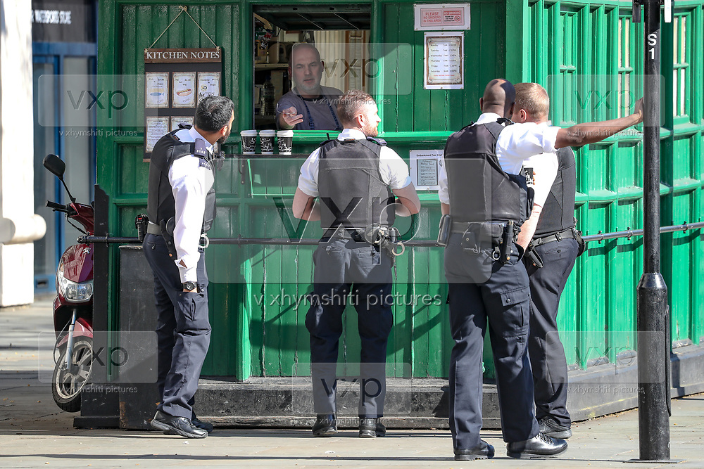 A general view of a Police foot Patrol buying coffee near Golden Jubilee Bridge in London, Wednesday, March 25, 2020. British lawmakers will vote later Wednesday to shut down Parliament for 4 weeks, due to the coronavirus outbreak. The new coronavirus causes mild or moderate symptoms for most people, but for some, especially older adults and people with existing health problems, it can cause more severe illness or death. (Photo/Vudi Xhymshiti)