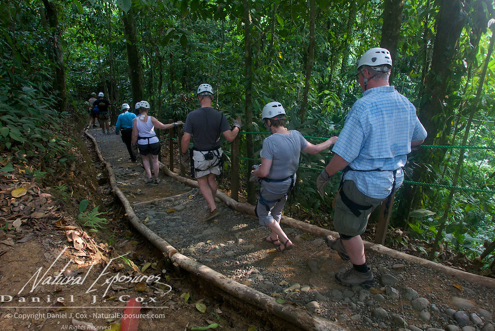 Our group walks to the next zip line platform. Costa Rica.