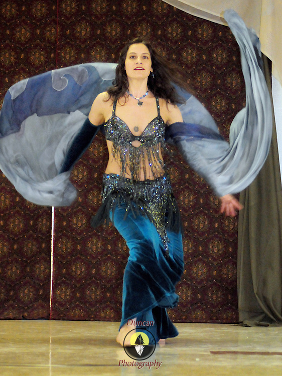 """4/5/09 -- BRUNSWICK, Maine. Helena """"Datura"""" Melone, a professional dancer and teacher from Montville, Maine demonstrates a veil and sword dance at the food raising event at Bath Elks Lodge. Photo by Roger S. Duncan."""