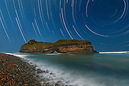 Star trails over Hole in the Wall, a rock formation on the Wild Coast in South Africa's Eastern Cape Province.