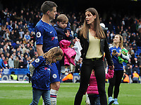 Football - 2018 / 2019 Premier League - Chelsea vs. Watford<br /> <br /> Cesar Azpilicueta of Chelsea walks around the pitch with his wife and children after the final home match, at Stamford Bridge.<br /> <br /> COLORSPORT/ANDREW COWIE