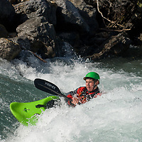 Kayaker Peter Thompson plays in waves on the Kananaskis River in the Canadian Rockies near Calgary, Alberta.