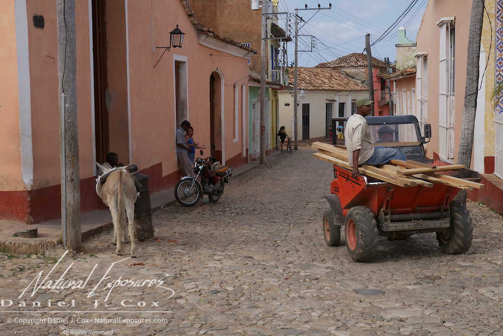 A local lumber yard moving lumber on the streets of Trindada, Cuba.