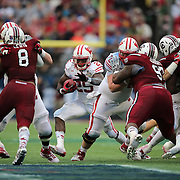 Wisconsin Badgers running back Melvin Gordon (25) runs the football during the NCAA Capital One Bowl football game between the South Carolina Gamecocks who represent the SEC and the Wisconsin Badgers who represent the Big 10 Conference, at the Florida Citrus Bowl on Wednesday, January 1, 2014 in Orlando, Florida. (AP Photo/Alex Menendez)