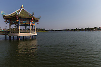 Chao Pu-Ya Chinese Spirit Shrine and Lake is adjacent to the Thai-Chinese Cultural Centre; together they form the focal point of  Chaloem Phrakiat Park in Udon Thani.  The shrine is a large Chinese spirit shrine with a Chinese rock garden that overlooks the lake. Two Chinese pavilions stand in the lake, serving as a view point in cool, breezy and shady surroundings. The golden dragon, used during the Thung Si Mueang annual festival in December, is kept here.  Most visitors assume that Chao Pu-Ya is a part of the Thai-Chinese Cultural Cener as they are across the street from each other.