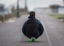 © Licensed to London News Pictures. 08/02/2016. Worthing, UK. A man on a skateboard is propelled by the wind on the sea front at Worthing as storm Imogen comes ashore. Photo credit: Peter Macdiarmid/LNP