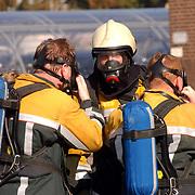 Gas lekkage bij BNI Huizen, Drager, perslucht, masker