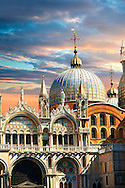 Facade with Gothic architecture and Romanesque domes of St Mark's Basilica, Venice