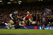 Steff Evans of Wales dives over to score his teams 4th try. Wales v Scotland, NatWest 6 nations 2018 championship match at the Principality Stadium in Cardiff , South Wales on Saturday 3rd February 2018.<br /> pic by Andrew Orchard, Andrew Orchard sports photography