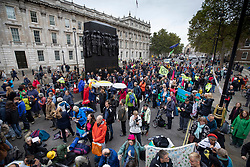 © Licensed to London News Pictures. 07/10/2019. London, UK. Extinction Rebellion activists gather in Whitehall in central London near Downing Street. Activists are converging on Westminster blockading roads in the area for at least two weeks calling on government departments to 'Tell the Truth' about what they are doing to tackle the Emergency. Photo credit: Peter Macdiarmid/LNP