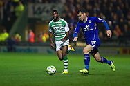 Joel Grant of Yeovil Town chases David Nugent of Leicester City ® during the Skybet Championship match, Yeovil Town v Leicester City at Huish Park Stadium in Yeovil on Tuesday 1st October 2013. Picture by Sophie Elbourn, Andrew Orchard Sports Photography,