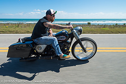 Bill Dodge out for a ride on his slammed down custom Road King during Daytona Bike Week. FL, USA. March 14, 2014.  Photography ©2014 Michael Lichter.