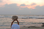 Woman enjoying the sunset during a summer vacation