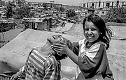 Daily life. Two children having fun inside the Palestinian Refugee Camps of Sabra and Shatila, Beirut, Lebanon 1998.