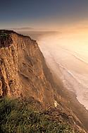 Sunrise on coastal cliffs above Drakes Beach, Point Reyes National Seashore, Marin County, California Sunrise light on coastal cliffs above Drakes Bay, Point Reyes National Seashore, Marin County, California