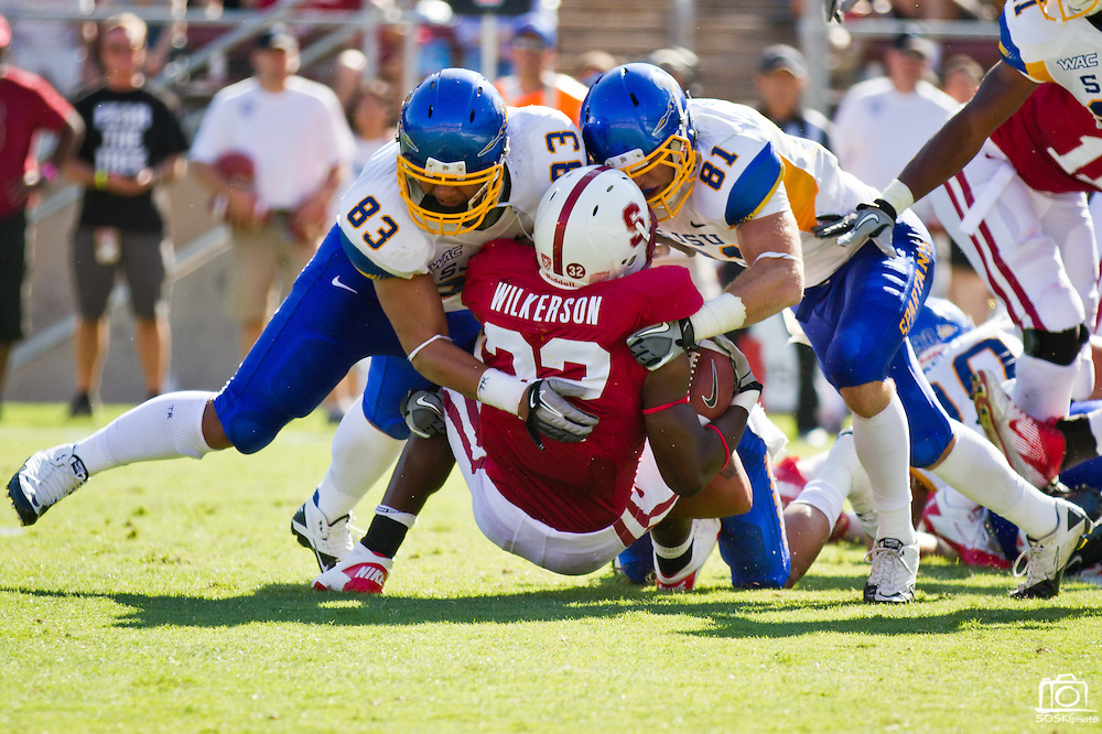 San Jose State Spartans' Cedric Lousi (83) and James Orth (81) tackle Remound Wright (22) in their 57-3 loss to Stanford (7), Palo Alto, Calif., Sept. 3, 2011.  (Spartan Daily/Stan Olszewski)
