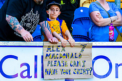 A young Mansfield Town fan holds up a cardboard sign directed towards Alex MacDonald of Mansfield Town - Mandatory by-line: Ryan Crockett/JMP - 19/04/2019 - FOOTBALL - One Call Stadium - Mansfield, England - Mansfield Town v Morecambe - Sky Bet League Two