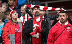 Arsenal fans before the Premier League match at the Emirates Stadium, London.