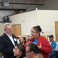 US NRC Facilitator Chip Cameron, left, listens to Anna Benally, right, a grassroots resident from Red Pond Road Community, as she asks the EPA and the U.S. Nuclear Regulatory Commission (NRC) representatives during the public scope meeting held at the Gallup Community Service Center in Gallup on Tuesday evening.