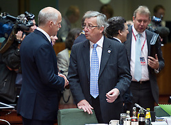Jean-Claude Juncker, Luxembourg's prime minister, right, speaks with George Papandreou, Greece's prime minister, during the European Summit meeting at EU Council headquarters in Brussels, Belgium, on Thursday, June 17, 2010. (Photo © Jock Fistick)