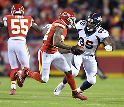 October 30, 2017 - Kansas City, MO, USA - Kansas City Chiefs cornerback Marcus Peters intercepts a pass intended for Denver Broncos tight end Jeff Heuerman before being tackled by tight end Virgil Green in the first quarter during Monday's football game on Oct. 30, 2017 at Arrowhead Stadium in Kansas City, Mo. (Credit Image: © John Sleezer/TNS via ZUMA Wire)