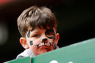 a Young fan with a painted face looks on during the match .Skybet football league championship match, Charlton Athletic v Derby County at The Valley  in London on Saturday 16th April 2016.<br /> pic by Steffan Bowen, Andrew Orchard sports photography.