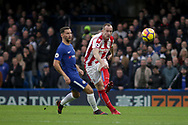 Charlie Adam of Stoke city clears the ball under pressure from Danny Drinkwater of Chelsea. <br /> Premier league match, Chelsea v Stoke city at Stamford Bridge in London on Saturday 30th December 2017.<br /> pic by Kieran Clarke, Andrew Orchard sports photography.