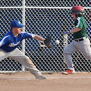 A young batter is out at first base during the Norwalk Little League baseball competition at Broad River Fields,  Norwalk, Connecticut. USA. Photo Tim Clayton
