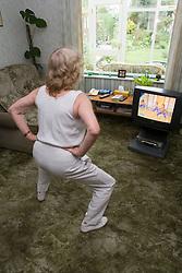 Woman exercising to an aerobics video,