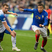 PARIS, FRANCE - March 25:  Kylian Mbappé #10 of France defended by Ragnar Sigurdsson #6 of Iceland during the France V Iceland, 2020 European Championship Qualifying, Group Stage at  Stade de France on March 25th 2019 in Paris, France (Photo by Tim Clayton/Corbis via Getty Images)