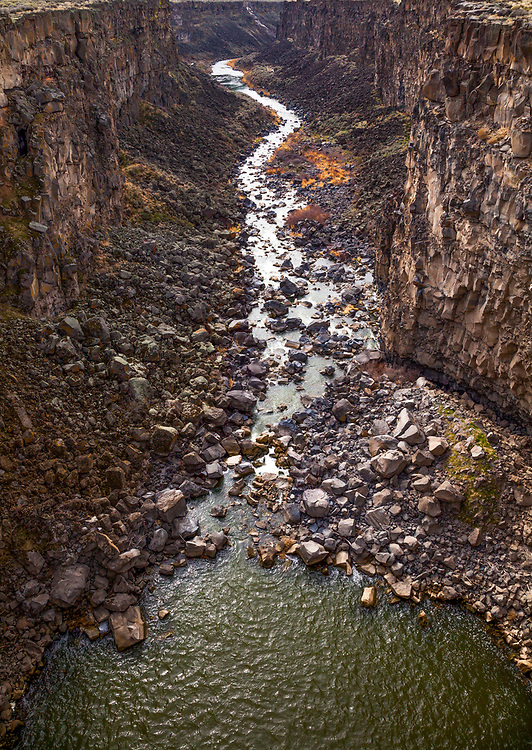 The Malad River crashes down stair step falls and into the Devils Washbowl, then cuts through a beautiful 250-foot gorge on its way to the Snake River, 2-1/2 miles downstream. Views of the gorge are best from the sturdy bridge that crosses the canyon. You can take a short hike to discover nearby fingers of the gorge where crystal-clear springs produce ponds and streams. Licensing and Open Edition Prints.