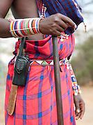 Maasai tribesman with a two way radio, Chyulu Hills region, Kenya