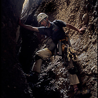 Mark Newcomb  descends a scary slot canyon below Shipton's Arch in the Kara Tagh Mountains of Xinjiang, China.