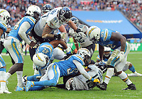 American Football - 2018 NFL Season (NFL International Series, London Games) - Tennessee Titans vs. Los Angeles Chargers<br /> <br /> Taylor Lewan (77) piles in to protect Tajae Sharpe (19), at Wembley Stadium.<br /> <br /> COLORSPORT/ANDREW COWIE