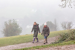 © Licensed to London News Pictures. 07/12/2020. Surrey, UK. Walkers enjoy the thick mist on top of Box Hill, Surrey as the Met Office issue a yellow weather warning for freezing fog with disruption to transport for the South East of England today with temperatures near 0c. The Government is expected to rolling out the new Pfizer/BioNTech's coronavirus vaccine tomorrow with reports it has already arrived in the UK for distribution to hospitals around the country. Photo credit: Alex Lentati/LNP