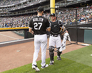 CHICAGO - JUNE 14:  Lucas Giolito #27 greets James McCann #33 of the Chicago White Sox in the bullpen prior to the game against the New York Yankees on June 14, 2019 at Guaranteed Rate Field in Chicago, Illinois.  (Photo by Ron Vesely)  Subject:  Lucas Giolito; James McCann