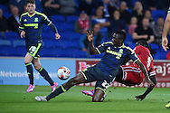 Kenneth Omeruo of Middlesbrough © slides in to deny Kenwyne Jones of Cardiff city. Skybet football league championship match, Cardiff city v Middlesbrough at the Cardiff city stadium in Cardiff, South Wales on Tuesday 16th Sept 2014<br /> pic by Andrew Orchard, Andrew Orchard sports photography.