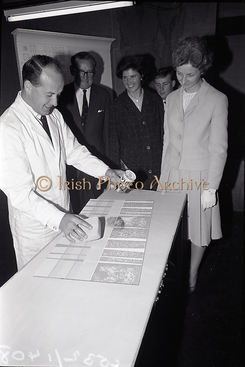 """25/06/1965<br /> 06/25/1965<br /> 25 June 1965<br /> Views of the I.C.I. (Imperial Chemical Industries) """"Vymura"""" wallpaper exhibition at the Building Centre, Baggott Street, Dublin. Mr. Alistair Fulton, (Technical Representative of the Paints Division, I.C.I.) demonstrates the ease with which the wall covering can be cleaned."""