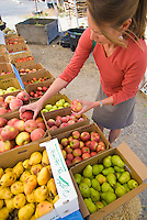 A young woman shops at a farm stand in Jackson, Wyoming.
