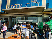 28 JANUARY 2016 - BANGKOK, THAILAND: Tourists go in and out of River City, a riverside shopping mall in Bangkok. It is undergoing a renovation. It will be an antiques and arts shopping destination when the work in completed in 2016. Tourist boats use the mall's pier to drop off tour groups until the renovation is finished.        PHOTO BY JACK KURTZ