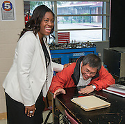 Dr. Nghia Le, right, reacts after principal LaShonda Bilbo-Ervin, left, tells him he has been recognized as a finalist in the 2015 HEB Excellence in Education Awards at Washington High School, March 12, 2015.