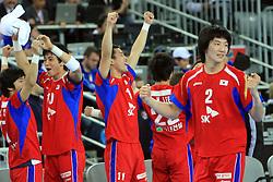 Team of Korea (Yikyeong Jeong (2) of Korea) celebrates during 21st Men's World Handball Championship 2009 Main round Group I match between National teams of Slovakia and Korea, on January 24, 2009, in Arena Zagreb, Zagreb, Croatia.  (Photo by Vid Ponikvar / Sportida)