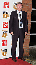© Licensed to London News Pictures . 27/03/2014 . Manchester , UK . Sir Alex Ferguson arrives at a gala dinner at Manchester United Football Club in support of United for Colitis , in aid of Crohn's And Colitis UK . Photo credit : LNP