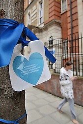 A message attached to a tree supporting Charlie Gard outside the entrance to Great Ormond Street Hospital in London, as Charlie's parents are preparing to return to court for a hearing at which the terminally-ill baby's future could be decided.