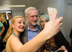 © Licensed to London News Pictures. 26/09/2015. Brighton, UK. Leader of the Labour Party JEREMY CORBYN poses for a selfie with your entrepreneurs while visiting Entrepreneurial Spark in Brighton, a group that promotes entrepreneuring. The visit takes place on the eve of the Labour Party conference, which is being held in Brighton  Photo credit: Ben Cawthra/LNP