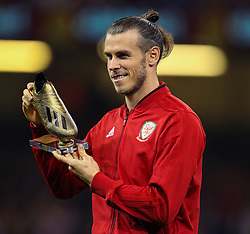 October 11, 2018 - Cardiff City, Walles, United Kingdom - Cardiff, Wales October 11, 2018.Gareth Bale of Wales is presented with a Golden Boot at half time during the Exhibition Match between Wales and Spain at Principality stadium, Cardiff City, on 11 Oct  2018. (Credit Image: © Action Foto Sport/NurPhoto via ZUMA Press)